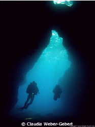 Xlendi cave - with divers - natural light by Claudia Weber-Gebert 